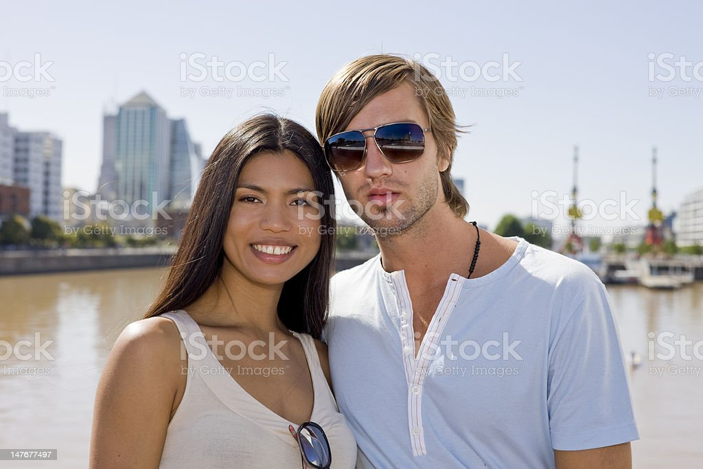 Happy couple A happy couple pose for the camera under the hot sun (Adobe RGB) Adult Stock Photo