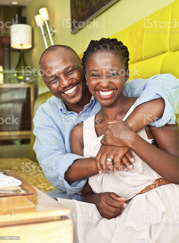 Happy couple Portrait of happy african couple sitting in the cafe, smiling at the camera. 30-34 Years Stock Photo