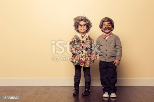 Two young kids dressed up as an old people couple are in love many years down the road.