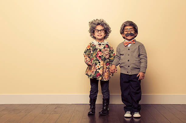 Happy Couple Two young kids dressed up as an old people couple are in love many years down the road. dressing up stock pictures, royalty-free photos & images