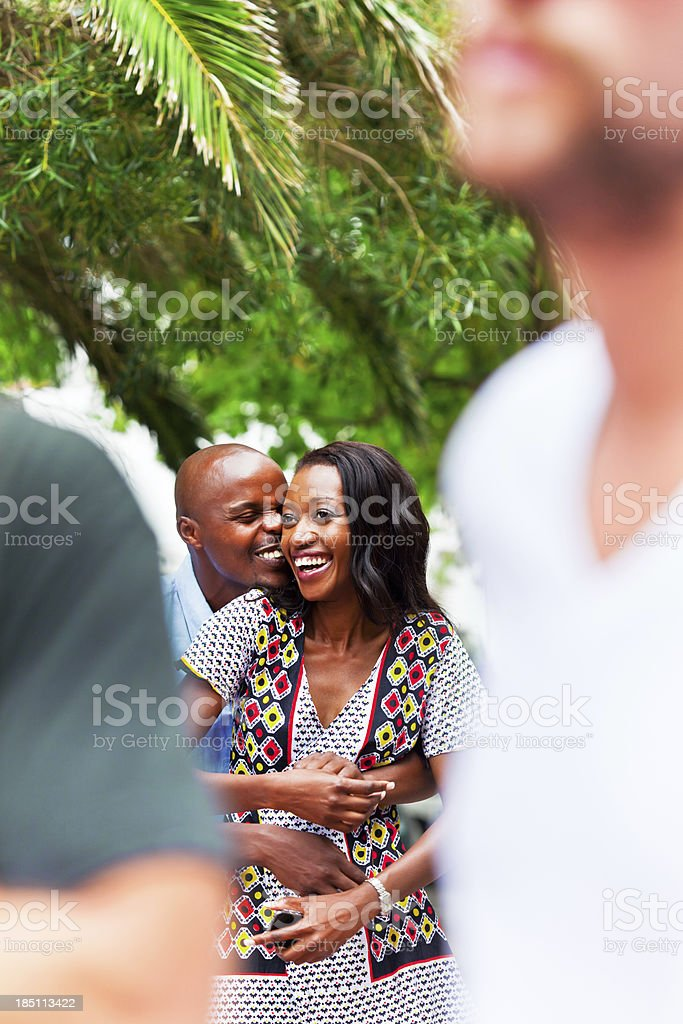 Happy couple Happy african couple embracing at the street. Adult Stock Photo