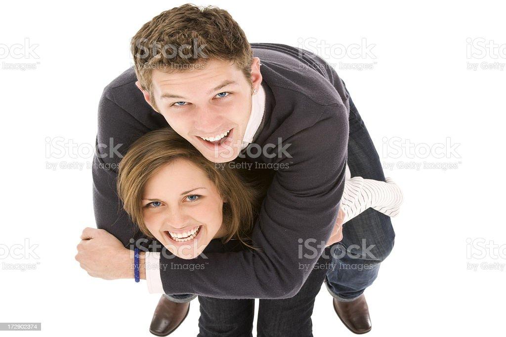 Happy couple playing piggyback stock photo