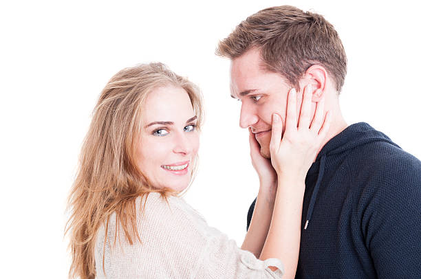 Happy couple portrait cuddling and being affective Happy couple portrait cuddling and being affective with each other isolated on white background affective stock pictures, royalty-free photos & images