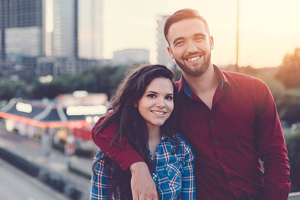 Happy couple portrait in the city Young people looking at camera sister stock pictures, royalty-free photos & images