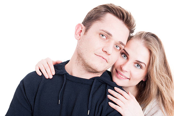 Happy couple posing and being affective Happy couple posing and being affective with each other isolated on white background affective stock pictures, royalty-free photos & images