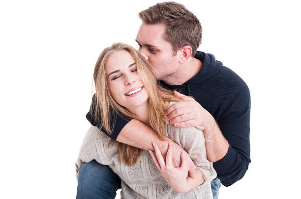 Happy couple posing being affective and kissing Happy couple posing being affective with each other and kissing isolated on white background affective stock pictures, royalty-free photos & images