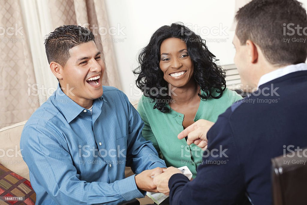 Happy couple receiving advice from financial advisor royalty-free stock photo