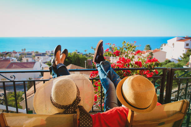 happy couple relax on balcony terrace happy couple relax on balcony terrace, on vacation in Europe spain stock pictures, royalty-free photos & images