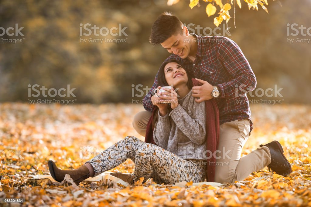 Happy couple relaxing and enjoying in autumn day together. stock photo