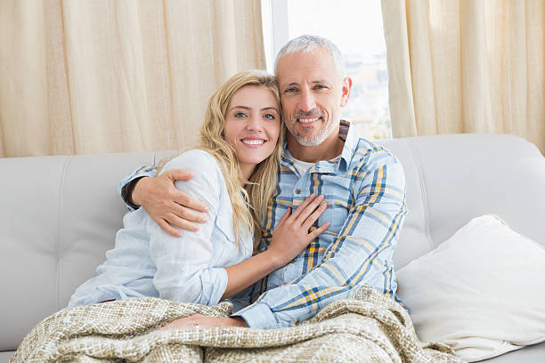 Happy couple relaxing on the couch stock photo