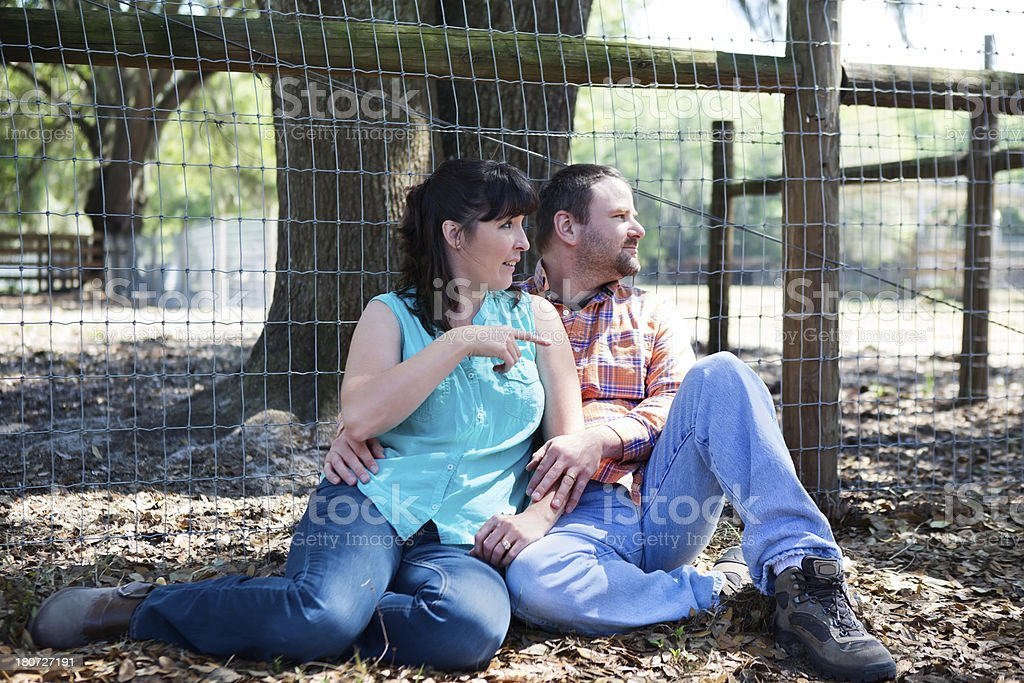Happy couple relaxing outside royalty-free stock photo