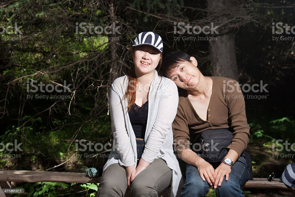 happy couple rest in the woods stock photo