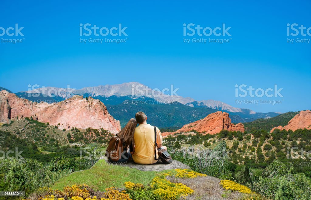 Happy couple resting and enjoying beautiful mountain view. stock photo