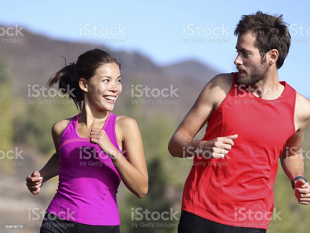 Happy couple running stock photo