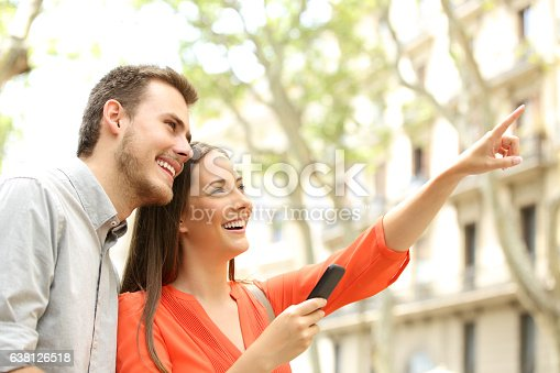 istock Happy couple searching home in the street 638126518