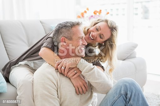 istock Happy couple sitting and cuddling 518355871