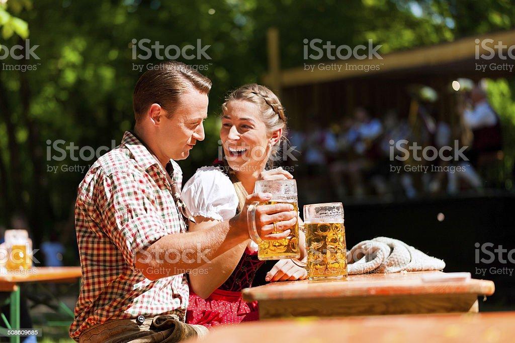 Happy Couple sitting in Beer garden stock photo