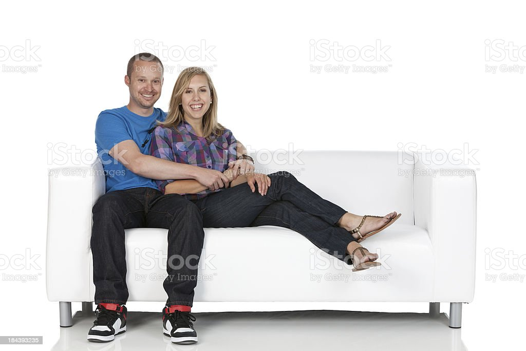 Happy couple sitting on a couch royalty-free stock photo