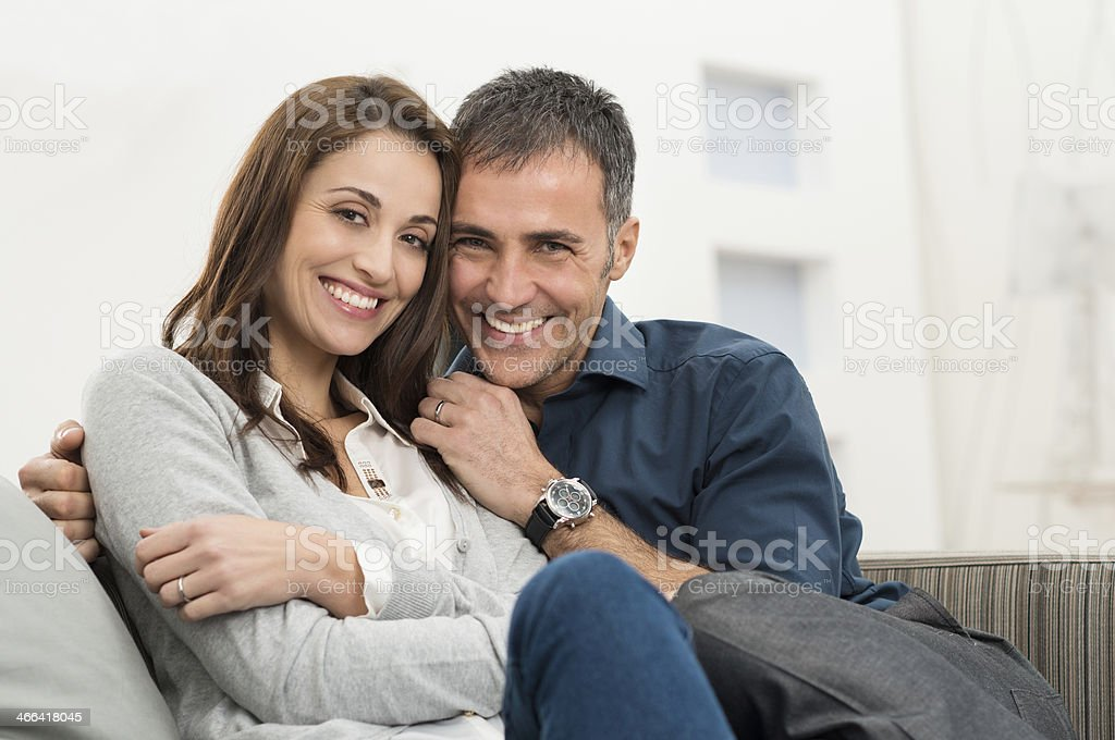 Happy Couple Sitting On Couch stock photo