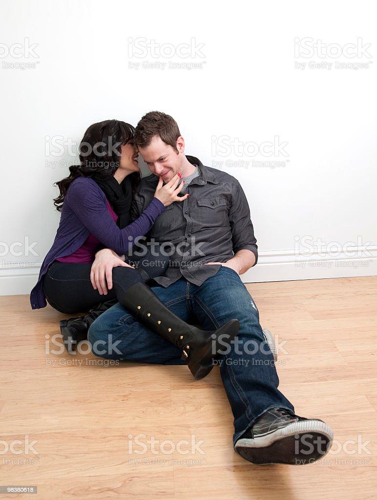 Happy couple sitting on floor talking royalty-free stock photo