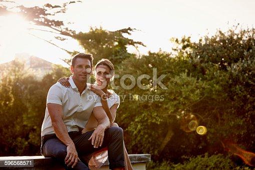 Portrait of happy mid adult couple sitting on floorboard