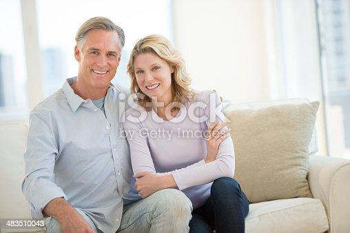 istock Happy Couple Sitting On Sofa In Living Room 483510043