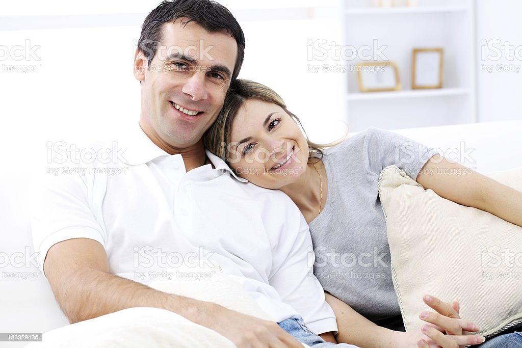 Happy couple  sitting together in the home. royalty-free stock photo