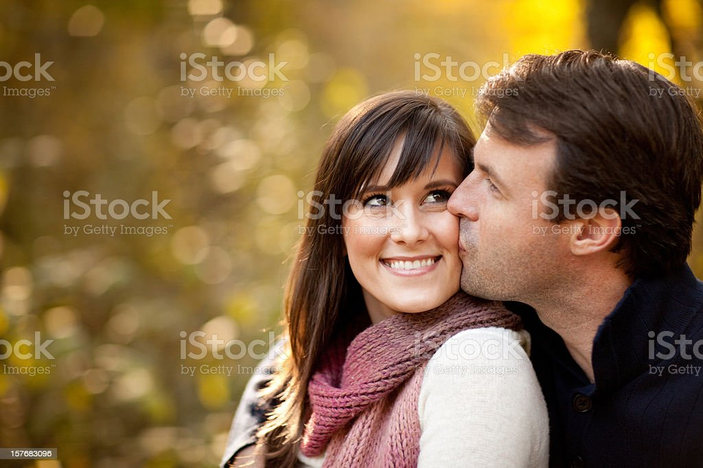 Happy Couple Sitting Together Outside During Autumn royalty-free stock photo