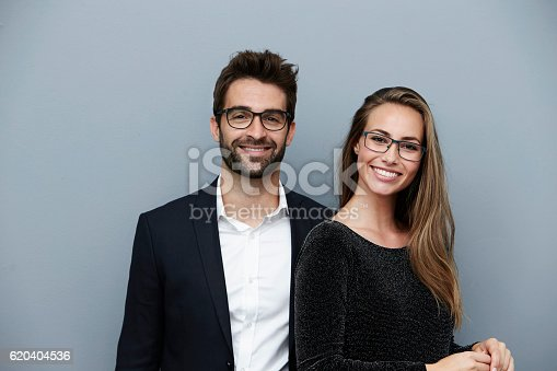 istock Happy couple smiling at camera, portrait 620404536