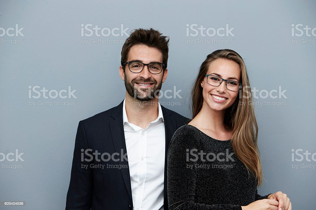 Happy couple smiling at camera, portrait stock photo