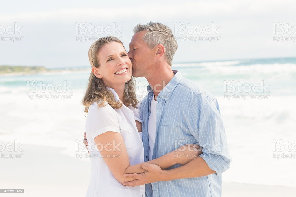 Happy couple smiling at each other stock photo