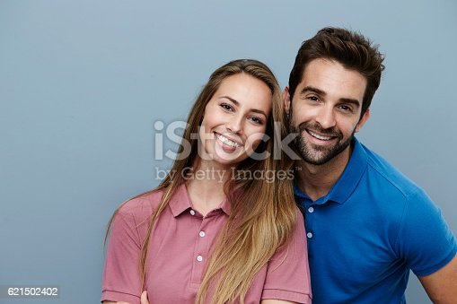 istock Happy couple smiling in polo shirts, portrait 621502402