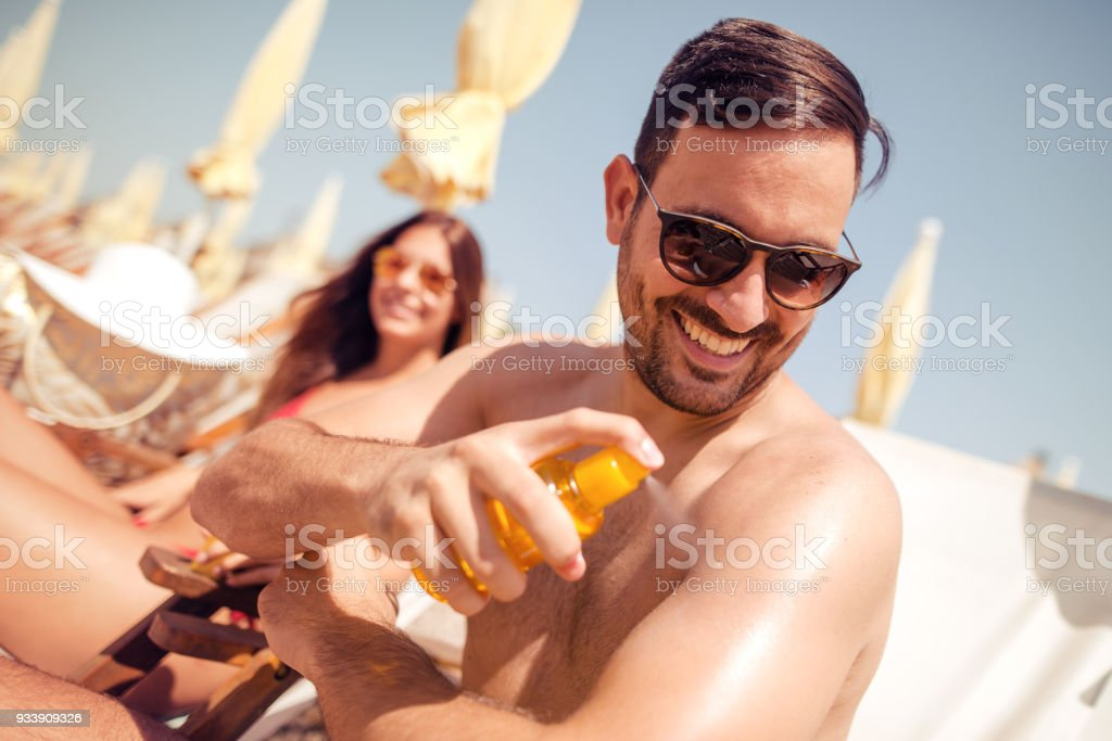 Happy couple smiling on the beach stock photo