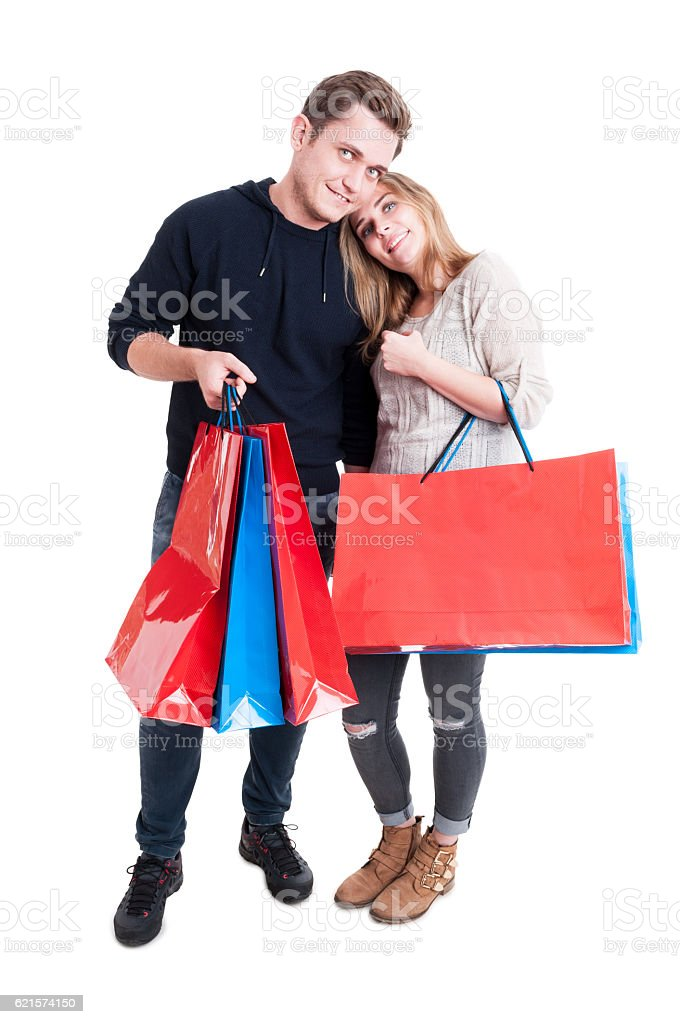 Happy couple standing and holding bunch of shopping bags photo libre de droits