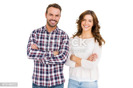 673176670 istock photo Happy couple standing with arms crossed 673196322