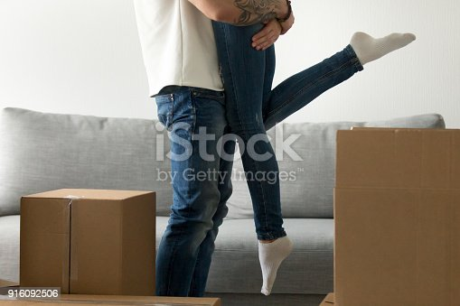938682826istockphoto Happy couple starting new life together, man embracing lifting w 916092506