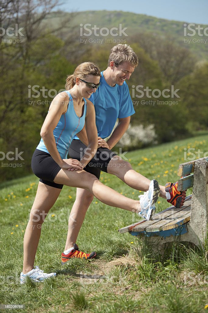 happy couple stretching royalty-free stock photo