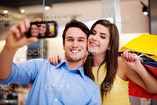 Happy couple taking a photo in the shopping mall picture id178619311?b=1&k=6&m=178619311&s=612x612&h=9wxwxuqqipt c4 s q8q1ljlzgxn71xw7y cb3frv4y=