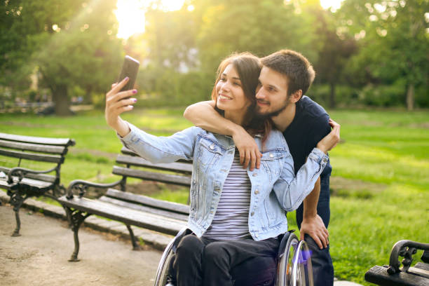 Happy couple taking a selfie stock photo