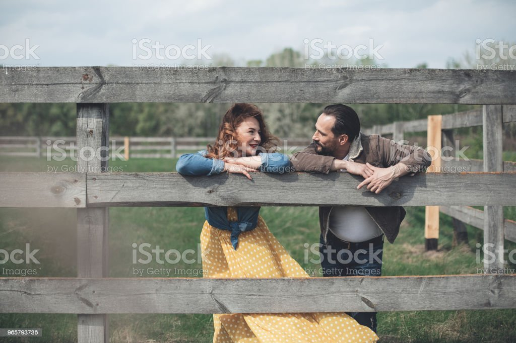 Happy couple talking and laughing in the nature - Royalty-free Adult Stock Photo