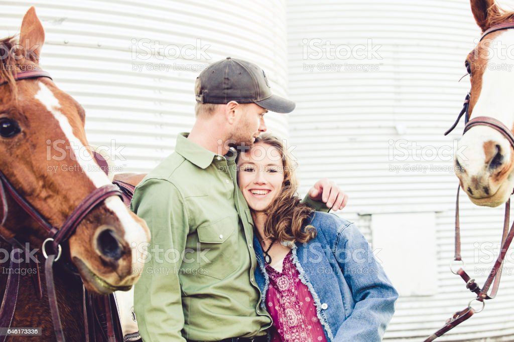 Happy Couple Together With Horses stock photo