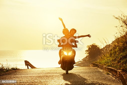 istock Happy couple travel motorcycle sea road 642509364