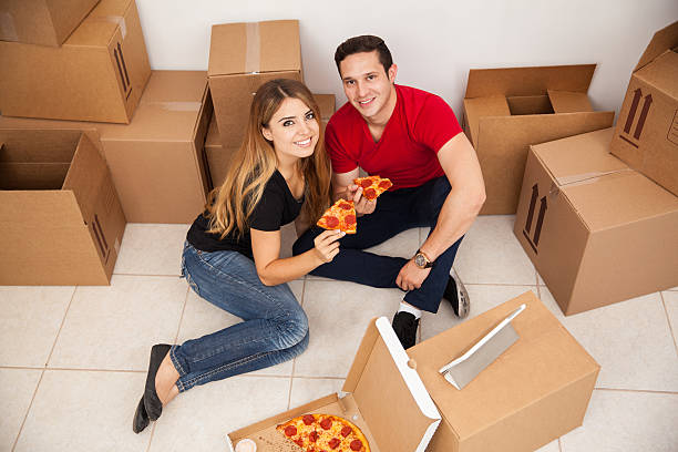 Happy couple unpacking stock photo