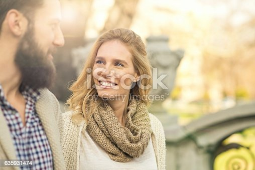 istock Happy couple walking around the city. 635931474