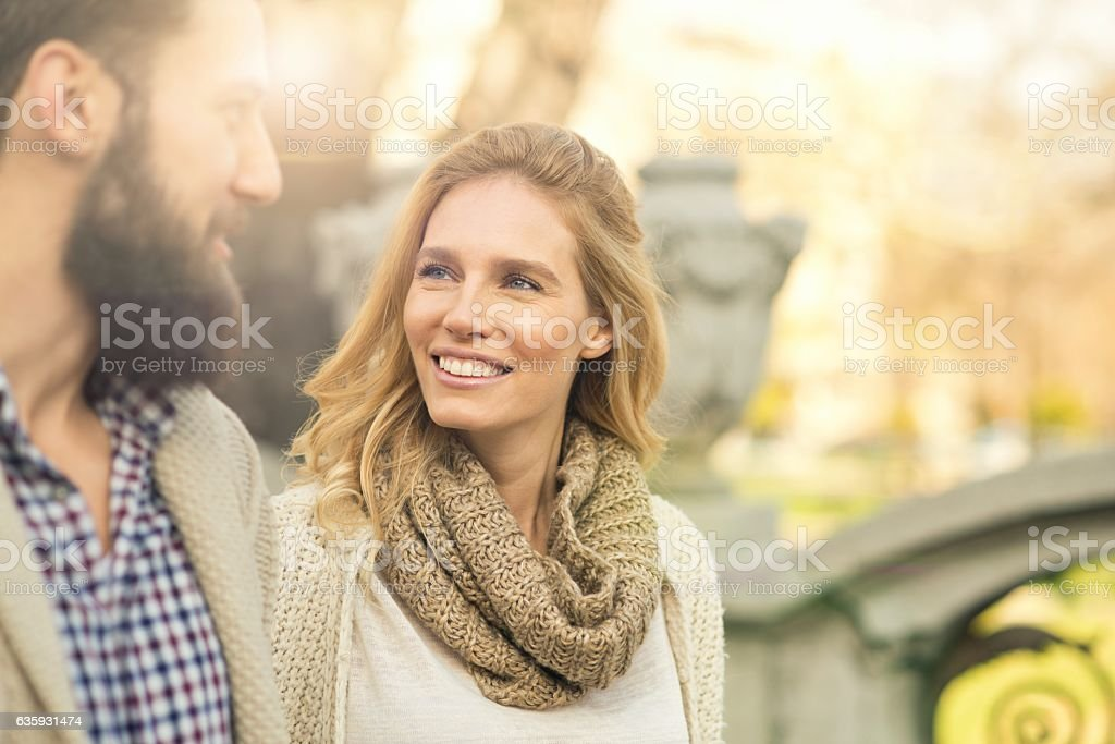 Happy couple walking around the city. stock photo