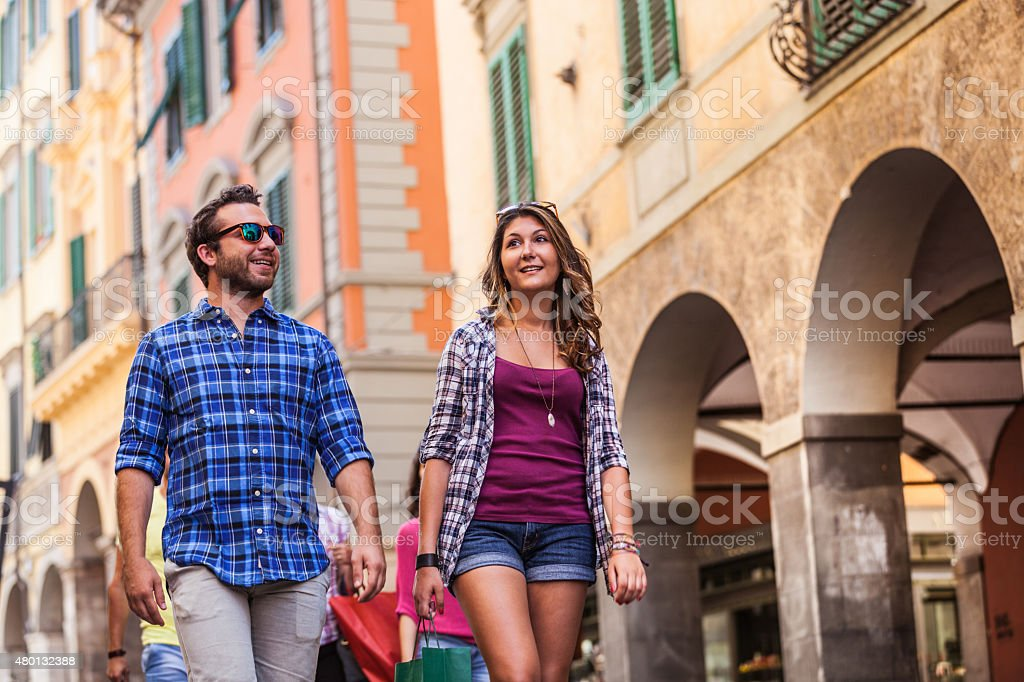 Happy couple walking in the city during summer stock photo