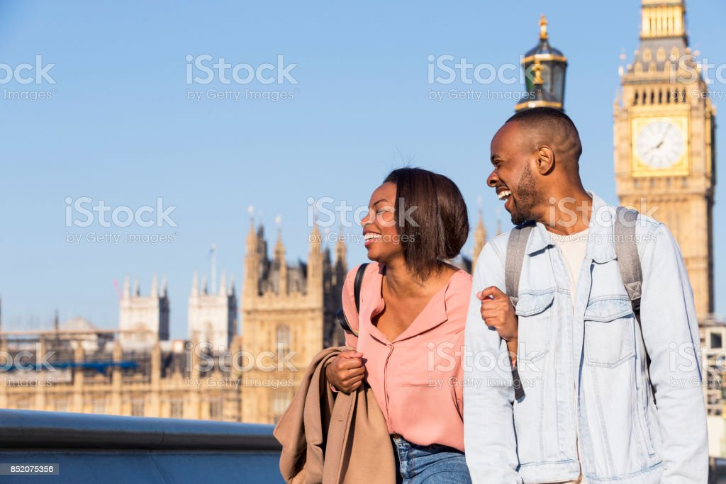 Happy couple walking jovially together in London stock photo