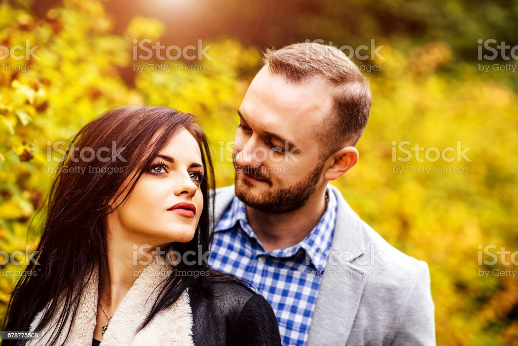 Happy couple walking outdoor in the park royalty-free stock photo