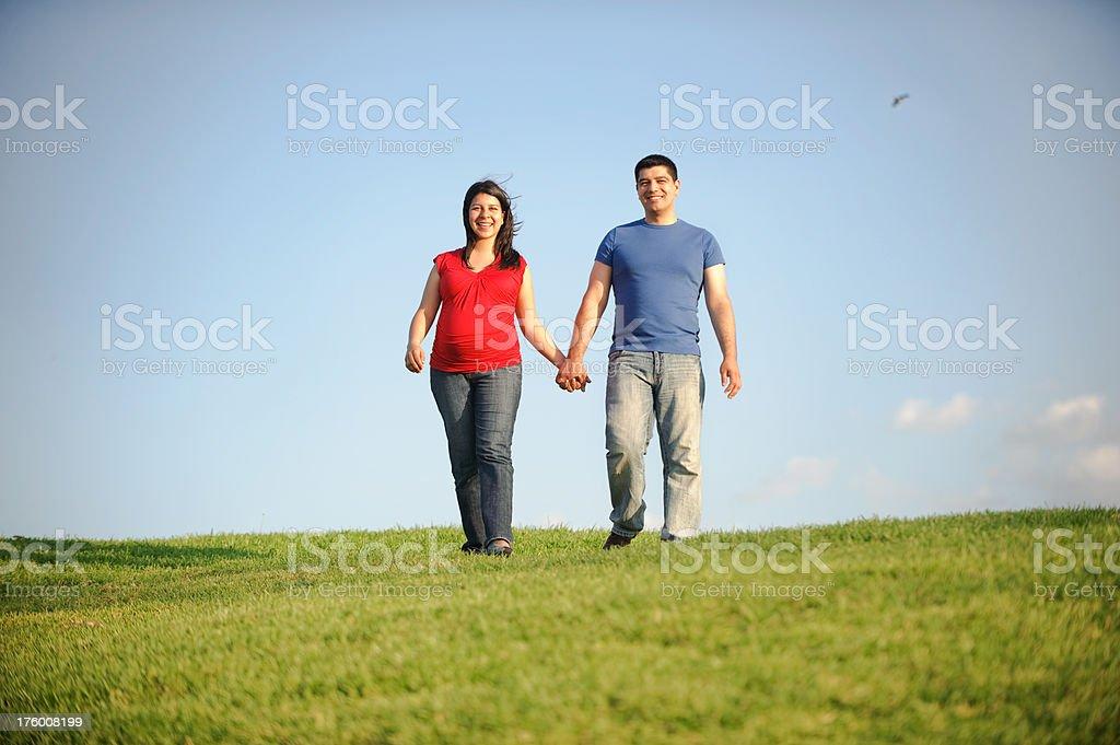 Happy couple walking royalty-free stock photo