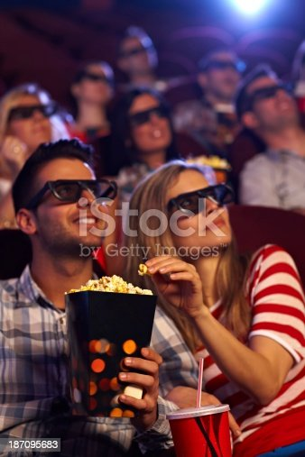 187095683 istock photo A happy couple watching a 3D movie 187095683